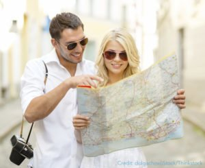 Couple looking at a map of PA travel