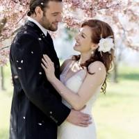 Couple's spring wedding under cherry blossom trees