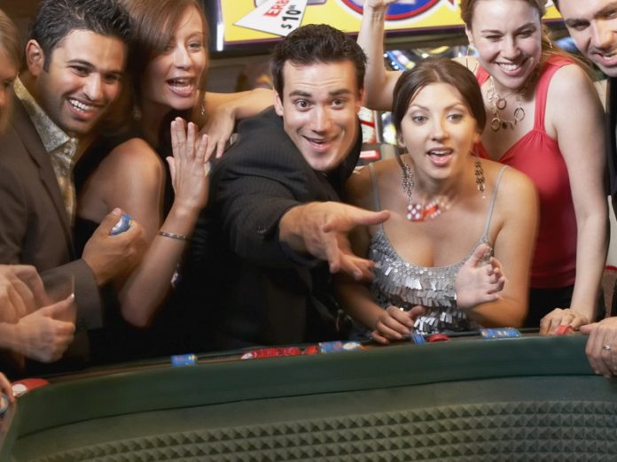 Friends playing Craps at the Sands Casino Resort in Bethlehem, PA