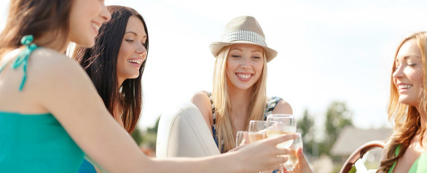 Group toasting wine glasses on a Lehigh Valley wine tour