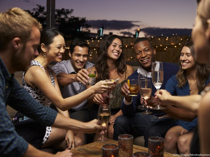 Group Of Friends Enjoying Night Out At Rooftop Bar, Nightlife in Bethlehem PA