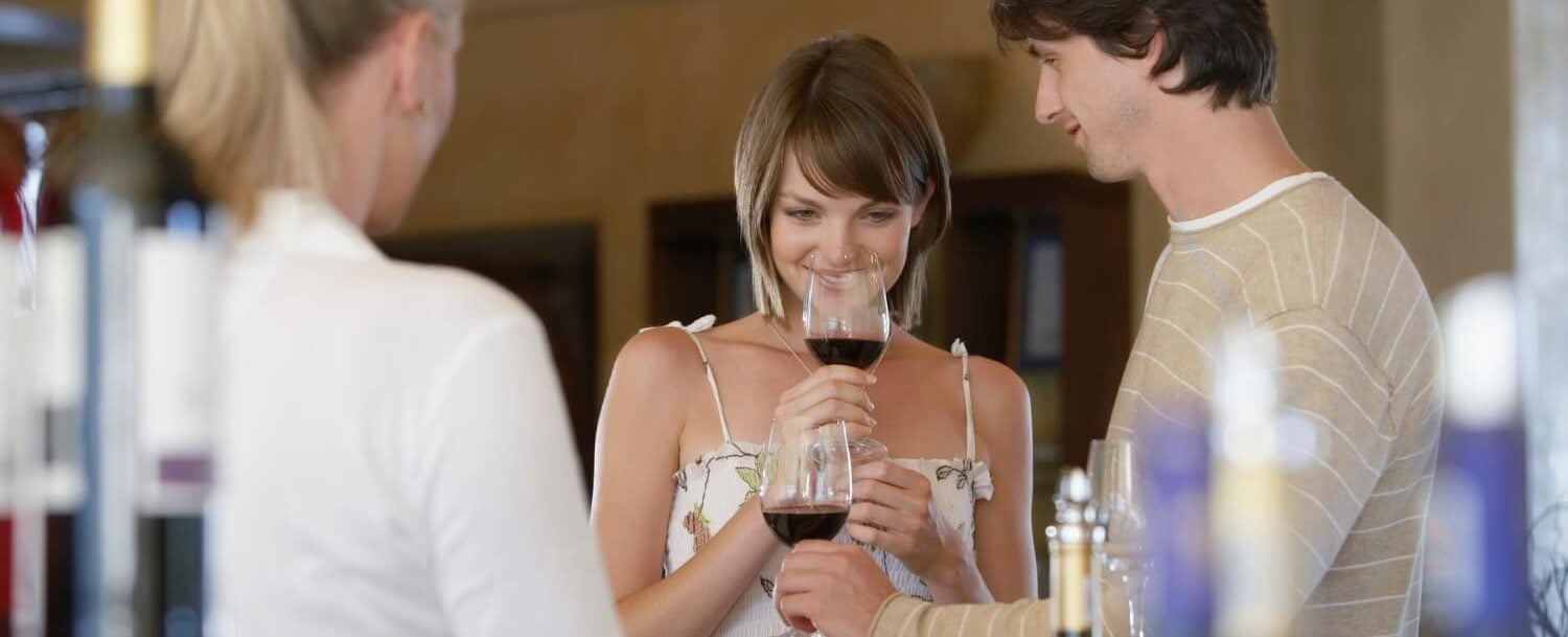 a young couple sampling wine from a vineyard on the lehigh valley wine trail